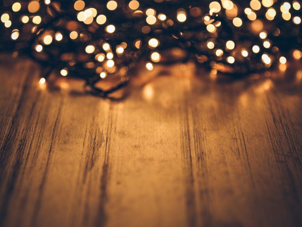 tangled christmas lights on a wood desk