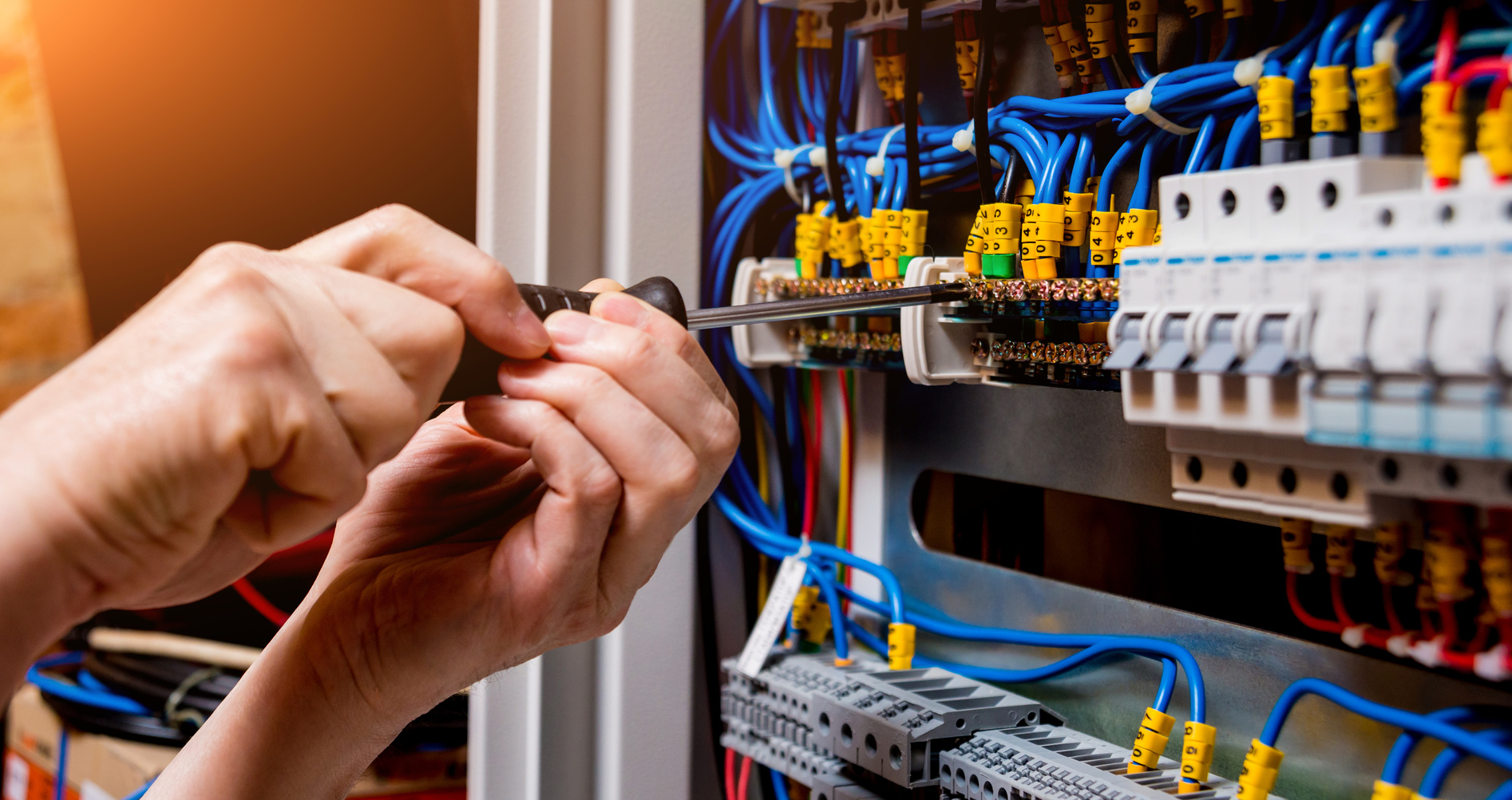 surrey electrician working on electric panel