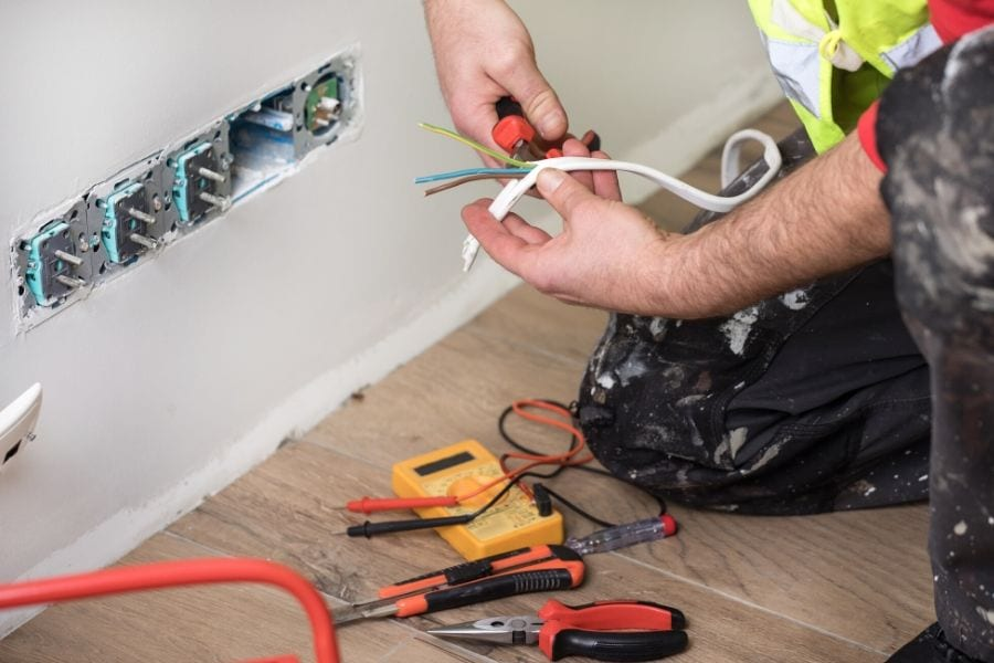chilliwack electrician expert is fixing electrical wiring system for homeowner in chilliwack